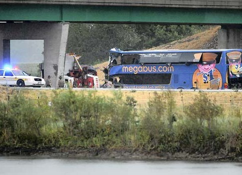 Illinois State Police and emergency personnel prepare to remove a Megabus on Thursday that struck a concrete pillar on Interstate 55 just north of Litchfield, Ill.