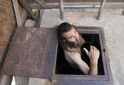 A Jewish man emerging from the mikvah in the village of Yishuv Ha'Da'at near Shilo, in Samaria.