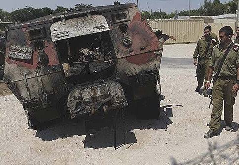 The wreckage of an Egyptian military vehicle after terrorists burst it through a security fence into Israel from Egypt, at an Israeli military base along the border with Egypt.