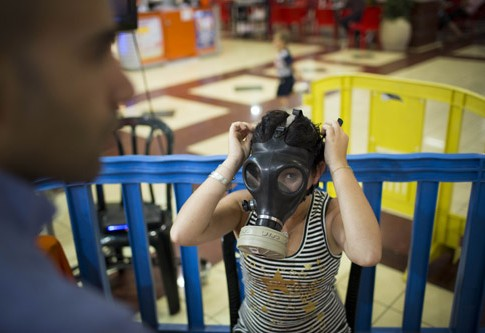 Israeli postal workers distributed gas masks to residents of Jerusalem on August 7 ,2012, due to recent warnings from Iran and Syria. Iran's president and other leaders have repeatedly threatened the State of Israel with violence and destruction.