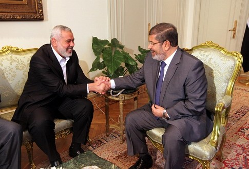 Egyptian President Mohammed Morsi, right, meets the Hamas Prime Minister of Gaza, Ismail Haniyeh in Cairo
