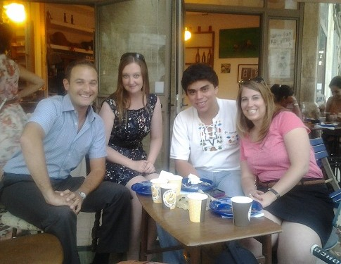 International participants from New Zealand and El Salvador at an Israel coffee shop in Jerusalem with StandWithUS Israel director, Michael Dickson.