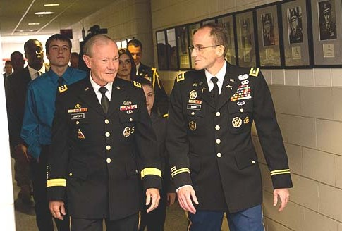 Chairman of the U.S. Joint Chiefs of Staff General Martin Dempsey (L.) and Army Lt. Col Mark Webber walking.