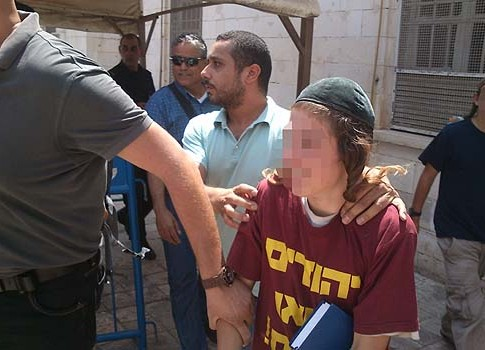 One of the children being taken out of a court hearing last week.