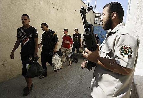 Hamas guard watching over Palestinian prisoners waiting to be released from the central prison in Gaza City.