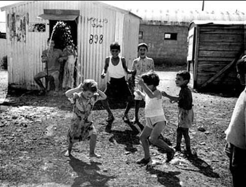 Jewish immigrant children from Arab countries at the Talpiot transit camp on the outskirts of Jerusalem, 1954.