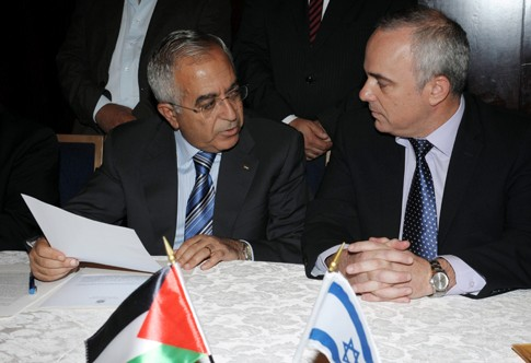 "Israeli Finance Minister Yuval Steinitz and PA ""Prime Minister"" Salam Fayyad signing an economic agreement in Jerusalem, July 21, 2012."