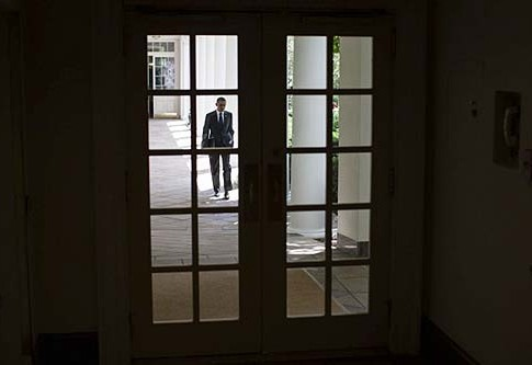 President Barack Obama walks along the Colonnade of the White House on his way to the Oval Office.