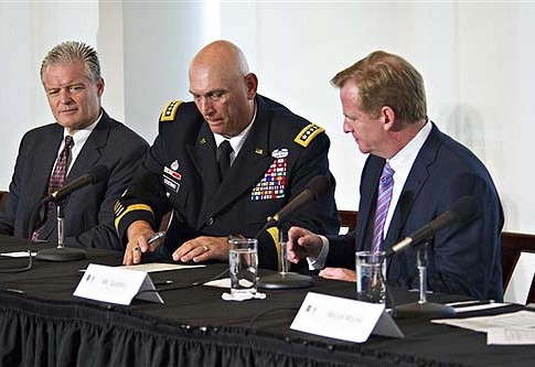 Army Chief of Staff Gen. Ray Odierno, center, signs the traumatic brain injury initiatives letter between the Army and the National Football League as NFL Commissioner Roger Goodell, right, looks on during a launch event at the U.S. Military Academy at West Point, N.Y., Aug. 30, 2012.