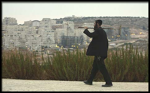 A Haredi man walking on the road to Modiin Elit.