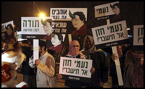 Jewish right-wing activists dressed as Arabs demonstrate against the New Israel Fund (NIF). The signs say