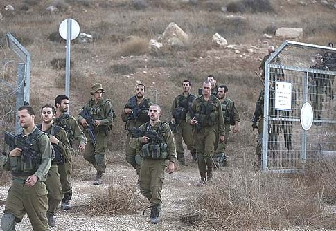 Israeli soldiers returning from a search for the remains of a drone in southern Israel, Saturday, Oct. 6, 2012.