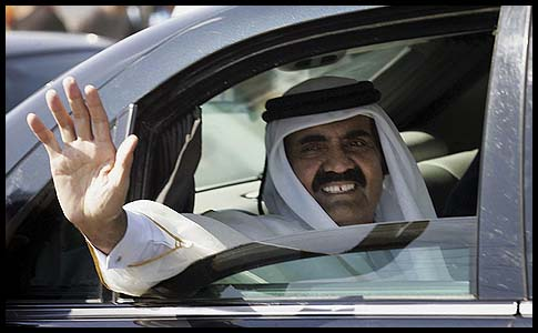 Qatari Emir Sheikh Hamad bin Khalifa al-Thani waves to the crowds at the Rafah border crossing with Egypt, Tuesday.