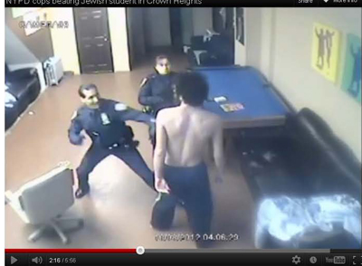 Video surveillance showing Officer Luis Vega about to punch Ehud HaLevy in the face.