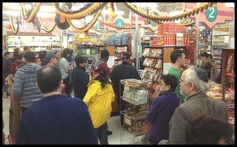 Fine Fare supermarket on Grand Street was packed right now with shoppers stocking up before the big storm.
