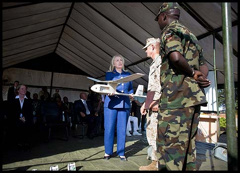 Hillary Giving Away Toys