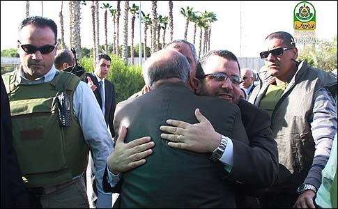 Prime Minister Hisham Kandil hugging a Hamas official upon entering Gaza by car Friday morning.