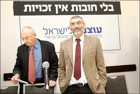 "Michael Ben Ari (R) and Aryeh Eldad under their campaign slogan ""No Duties – No Rights,"" introduced their new party ""Power to Israel"" at a press conference in Jerusalem, Tuesday, November 13, 2012."