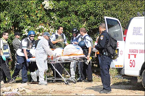 Three people were killed Thursday morning, November 15 2012, when a Grad rocket hit an apartment building in Kiryat Malachi.