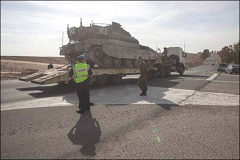 A truck carrying an Israeli tank seen near Mishmar Hanegev, southern Israel.