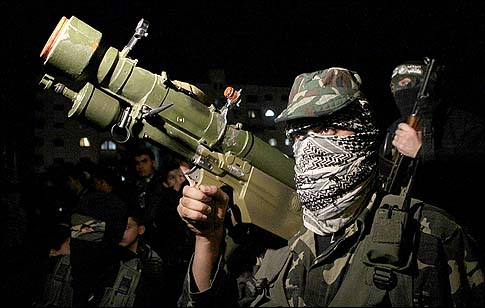Gunmen from the Ezzedine al-Qassam Brigades, the armed wing of Hamas, in Gaza City on November 22, 2012.