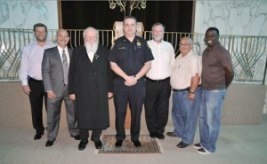 Miami Beach Police Chief Ray Hernandez (center) presented six Miami Beach chaplains with certificates of appreciation.