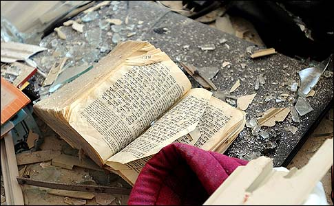 A bible covered with debris in the apartment in Kiryat Malachi that suffered a direct rocket hit this morning that killed three tenants.