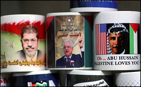 Mugs don't lie: Gaza vendor displaying popular souvenir mugs with Morsi (L), Abbas (C) and the beloved U.S. President.