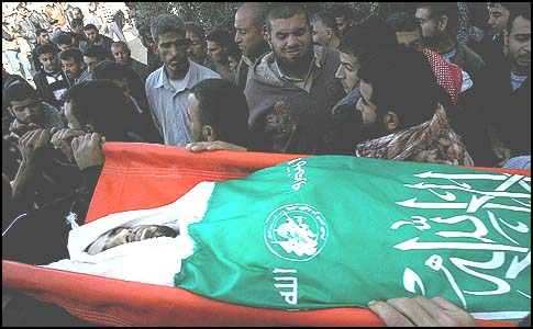 Arabs carry the body of Mahmoud Jarghoun, who was killed when the IDF opened fire on rioters near the border on December 1, 2012.