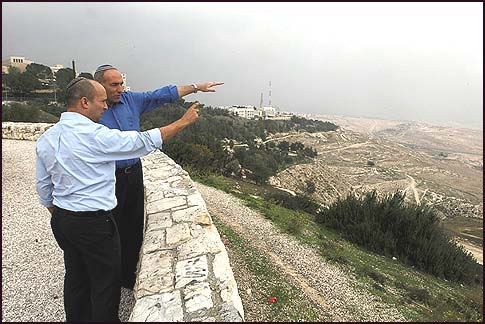 Jewish Home Party Chairman Naftali Bennett (L) and former IDF Gaza Formation commander Moti Yogev, pointing at the E1 zone.