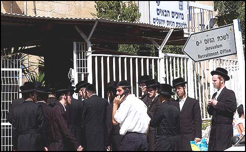 Haredi men standing in line outside the IDF Recruitment Office in Jerusalem.