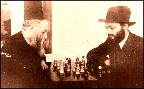 The sixth and seventh Lubavitc Rebbes playing chess on Nittel Nacht.