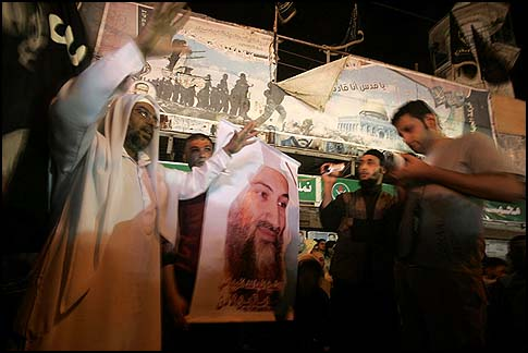 Salafi group holds a picture of Osama bin Laden during a protest in Rafah, southern Gaza Strip, Friday, May 6, 2011.