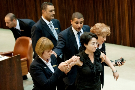 MK Haneen Zoabi being ejected from the Knesset Floor in July 2011. She flew into an uncontrollable rage while the Prime Minister was speaking.