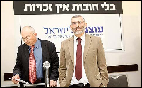 "Michael Ben Ari (R) and Aryeh Eldad seen underneath their campaign slogan ""No rights without duties."""