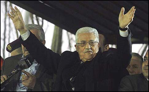 Palestinian Authority President Mahmoud Abbas waves to thousands of Fatah supporters in Ramallah. December 31, 2012.