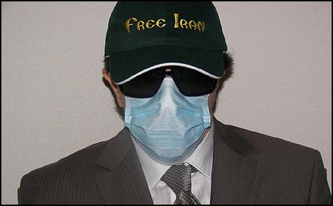 Raza Kahlili has never shown his face in public, for fear of retribution. He always appears wearing a baseball cap, dark glasses and a surgical mask.