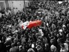 The coffin of Chokri Belaid is carried through the streets of the Djebel Jelloud district of Tunis.