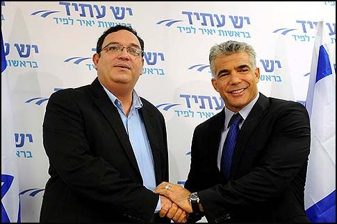 Yesh Atid Chairman Yair Lapid with MK Rabbi Shai Peron, one of the party's two Orthodox leaders.