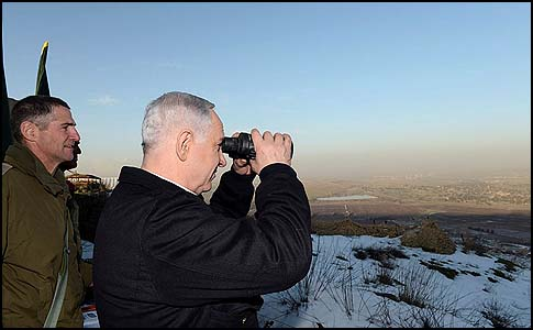 Prime Minister Benjamin Netanyahu surveying the Israeli Golan Heights, January 13, 2013.