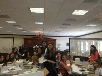 Chaya Aydel Seminary Students help the Hachnossos Kallah organization by stuffing, stamping and labeling 2,500 invitations for the annual event.