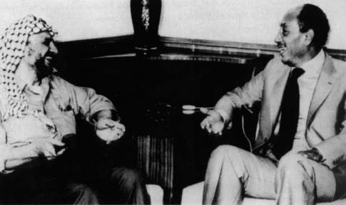 Undated photo of Yasser Arafat (L) sit and President Anwar Sadat (R) in Egypt.