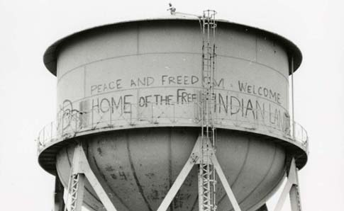Graffiti on a water tower at Alcatraz in a 1975 photo. The National Park Service recently cleaned and restored the graffiti.