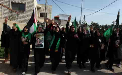 Palestinian women demonstrate in the village of Budrus, west of Ramallah, January 18, 2013.