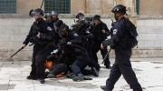 Israeli policeman on fire on Temple Mount after being hit by firebomb.