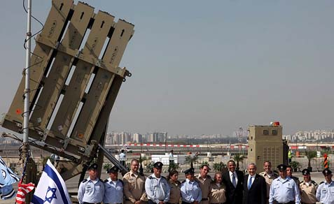 Group picture with a system – President Obama and his Israeli hosts in a photo op in front of an Iron Dome launcher, at Ben Gurion Airport near Tel Aviv on March 20 2013.