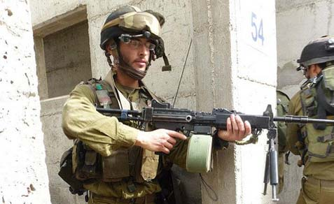 A Haredi Kfir Brigade soldier in an exercise simulating the takeover of a hostile urban area.