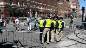 Police huddle at Marathon site