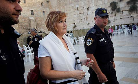"Lesley Sachs, director of ""Women of the Wall,"" being detained by police."