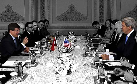 U.S. Secretary of State John Kerry (2nd R) met with Turkey's Foreign Minister Ahmet Davutoglu (L) in Istanbul April 7, 2013.